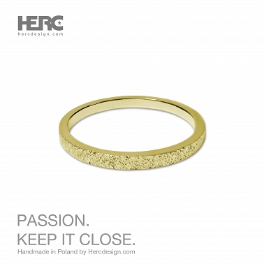Gold wedding ring with a texture