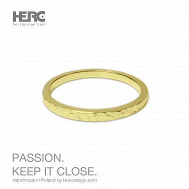 A thin gold ring with a texture